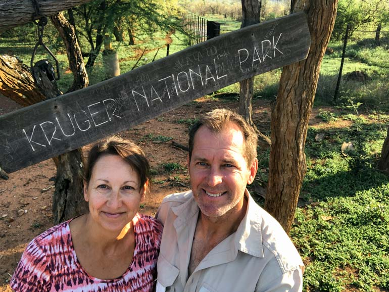 Lars and Shelley by a sign that says Kruger National Park