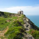 Memory-Chapel-CAbo-Espichel - white building on the edge of a cliff