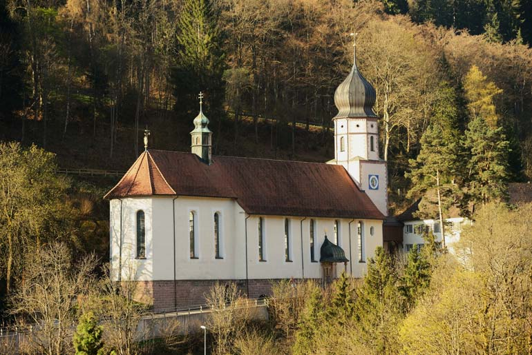Triberg Church surrounded by pine trees